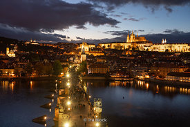 A night time view of the Charles Bridge and Prague Castle as seen from the Old Town Bridge Tower in Prague, Czech Republic