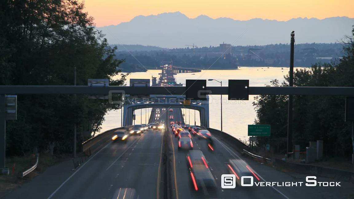 Seattle Washington State USA Seattle highway 520 traffic time lapse right after sunset with cars coming and going over bridge...