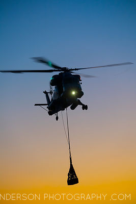 A SH-2G(I) Seasprite practices attaching and detaching an underslung load from the deck of HMNZS Canterbury..HMNZS Canterbury...