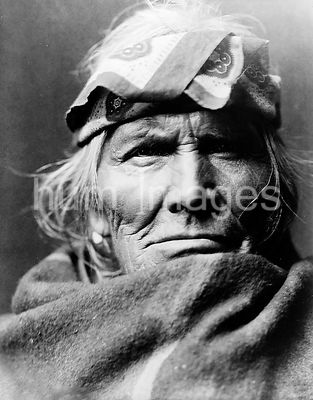 Edward S. Curtis Native American Indians - Si Wa Wata Wa, bust portrait, facing front, wearing blanket and handkerchief headb...