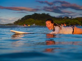 Surfing girl enjoying the moment