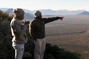 People at a viewpoint overlooking Samara Game Reserve, South Africa