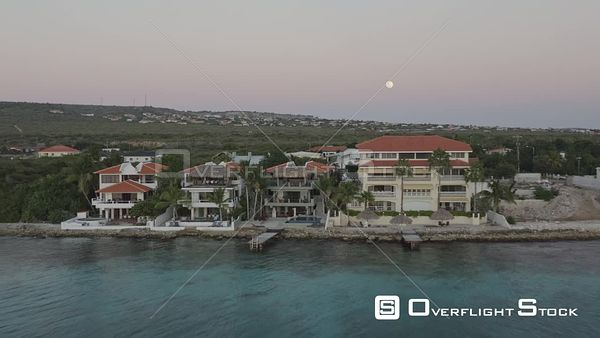 Bonaire Caribbean Closeup moving from ocean to residential neighborhood at dusk with full moon