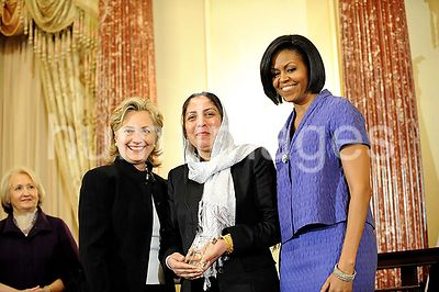 2010 - U.S. Secretary of State Hillary Clinton and First Lady Michelle Obama stand with Honoree Col. Shafiqa Quraishi of Agha...