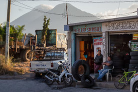 These two looked like they were posing just for me in front of their furniture and tire repair shops with the volcanoes in th...