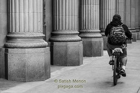 Bicyclist and Pillars, San Jose, CA, USA