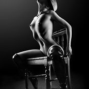 Nude woman on chair 2