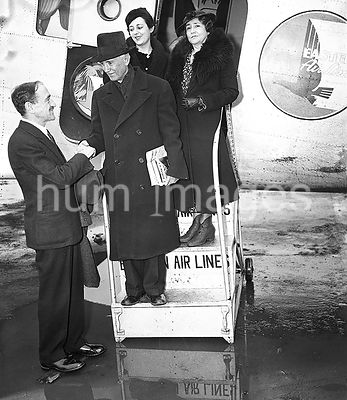 Group of passengers exiting an airplane ca. February 1936