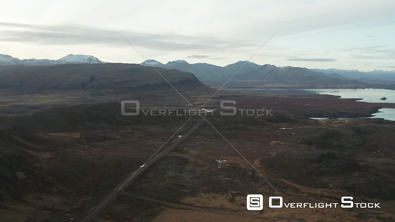 Flying Along a Road Towards Mountains from the Coast in Iceland.