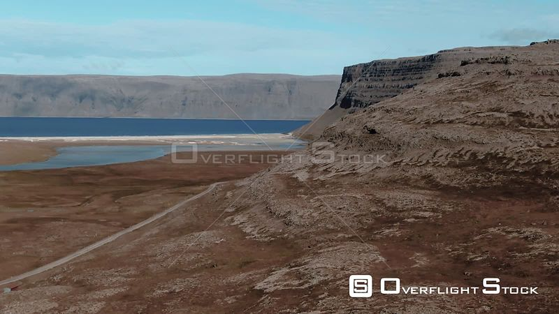 Mountains on a Fjord and a Red Volcanic Beach in West Iceland