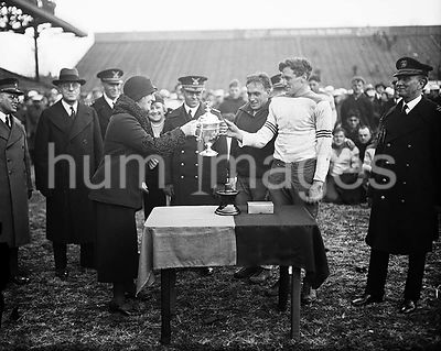 Trophy cup at football game (Army-Navy game?) ca. 1931