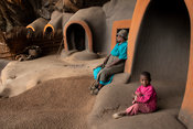 Woman with child at Ha Kome cave village, Lesotho