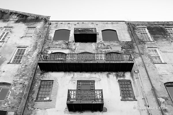 OLD BUILDING FACADE RIVERWALK AREA HISTORIC SAVANNAH GEORGIA BLACK AND WHITE