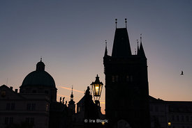 A  dawn silhouette of the Old Town Bridge Tower as seen from Charles Bridge in Prague, Czech Republic