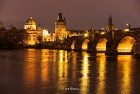 A night time view of the Charles Bridge and Vltava river  in Prague, Czech Republic