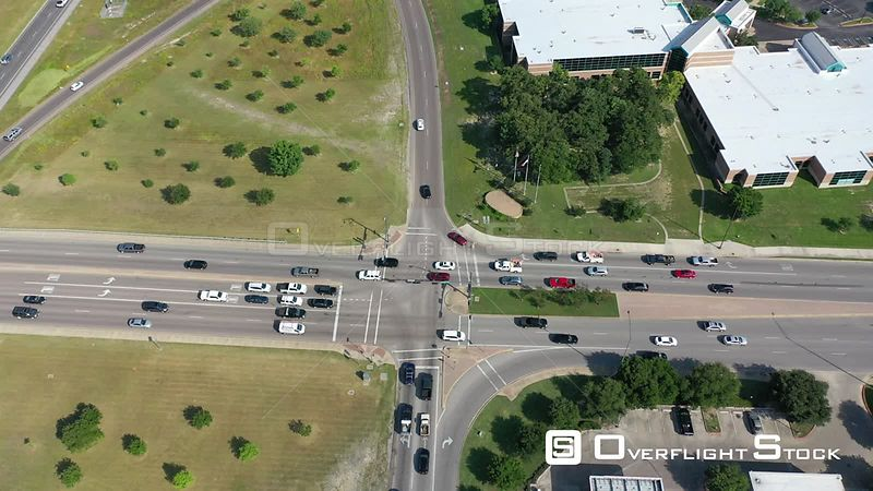 Sideways flight at rush hour over intersection of Hwy 6 and University Blvd, College Station, Texas, USA