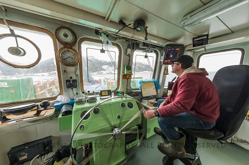 Captain steering Ferry Marine Voyager, which takes foot passengers and cargo between Burgeo and the outports of Grey River an...