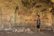 Tourist at Ha Sekonyela 2 rock art site, Tsatsane bushman paintings, Lesotho