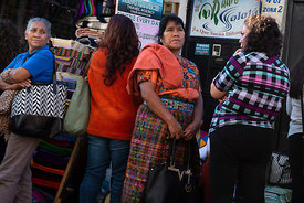 Women lining up to register for women-only evening classes. Panajachel, Guatemala
