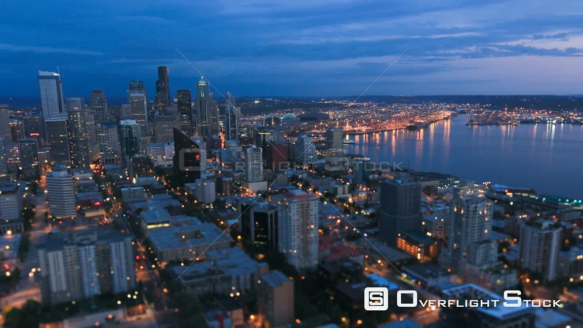 Seattle Washington State USA Seattle cityscape time lapse at dusk using a tilt shift lens with top half in focus.