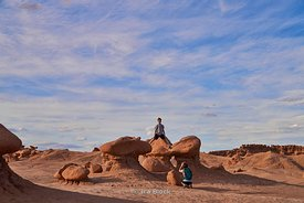 Visitors taking pictures at the rock formations in Goblin Valley State Park in Utah