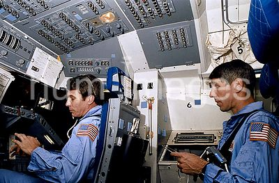 1986 - STS-29 crewmembers launch/landing procedural training in JSC mockup