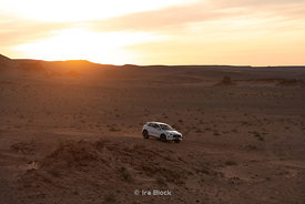 A 2019 INFINITI QX50 against the backdrop of The flaming Cliffs, Bayanzag in the South Gobi Desert, Mongolia