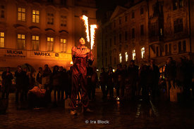 A fire eater performs at the Old Town Square in Prague, Czech Republic. The square is a gathering place for many street artis...