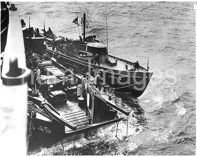 Probably 6 June 1944 - The 83-foot Coast Guard cutter USCG 1 off Omaha Beach on the morning of D-Day, tied up to an LCT and t...