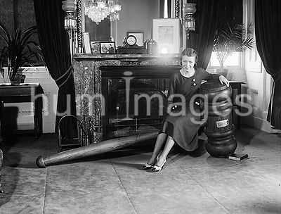 Woman seated on giant gavel ca. 1932