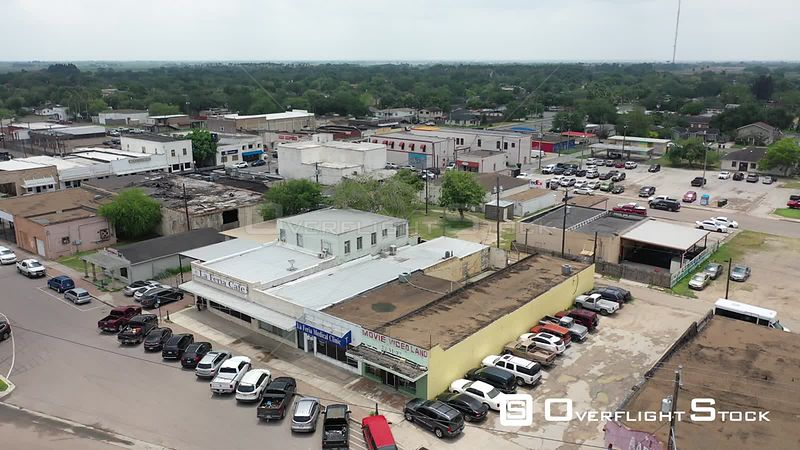 Low flight over La Feria Café and downtown buildings, La Feria, TX, USA