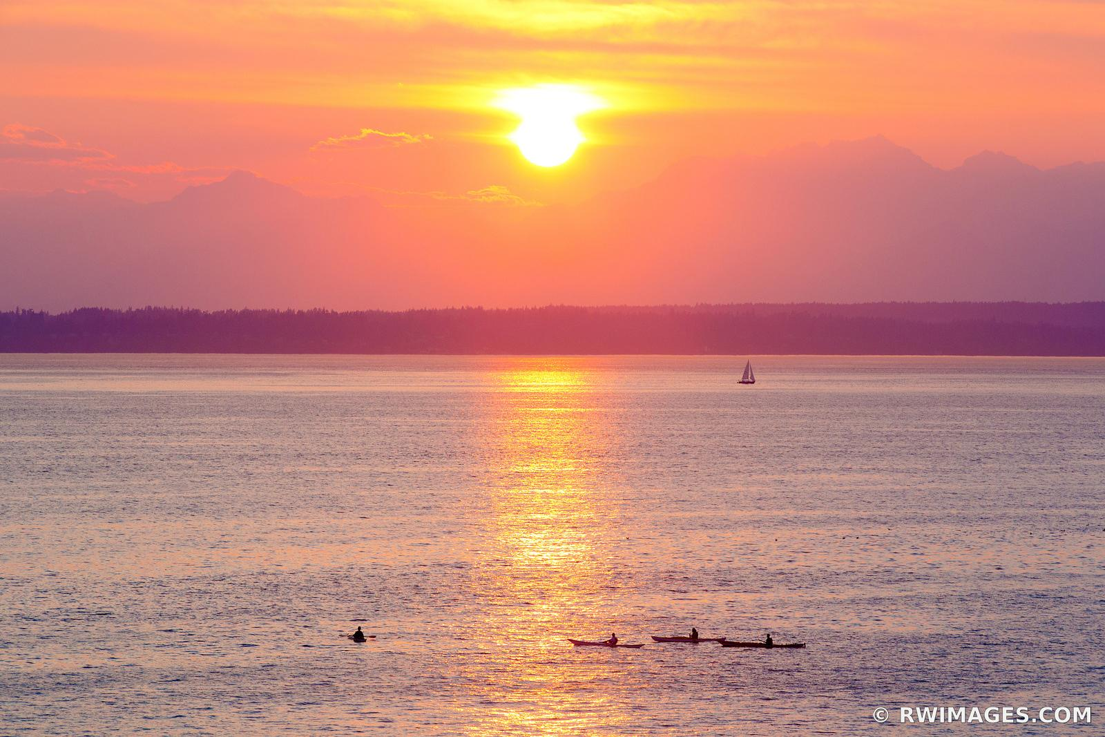 SEA KAYAKERS IN PUGET SOUND AT SUNSET SEATTLE WASHINGTON