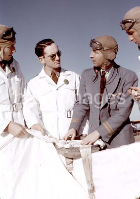 Instructor explaining the operation of a parachute to student pilots, Meacham Field, Fort Worth, Tex. January 1942