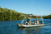 Tourist boat on the Kariega River, Sibuya Game Reserve, South Africa