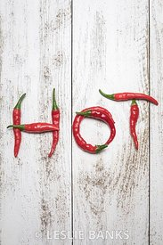 Word HOT spelled in Chili Peppers