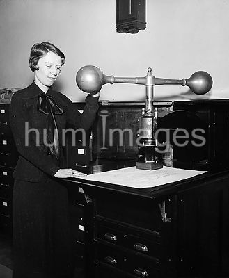 Woman demonstrating Device that impresses the Great Seal of the United States on certain official documents ca. 1935