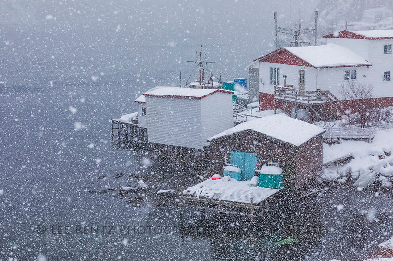 Fishing stages during a heavy snowstorm in Francois
