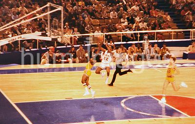 Oral Roberts University basketball player shoots a breakaway jump shot during a game with LSU ca. 1977