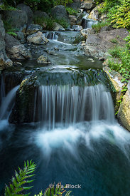 A scenic waterfall at the park by the Senso-ji temple in Tokyo, Japan