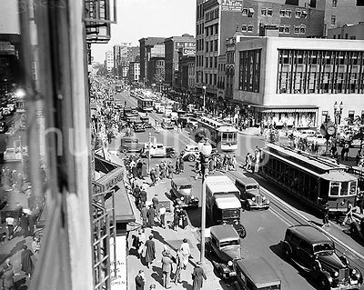 Streetview of Washington D.C. with busy traffic of cars and streetcars ca. 1935