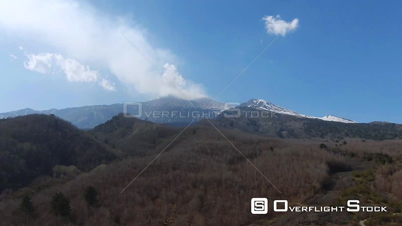 Mount Etna With Lava Rock and Trees