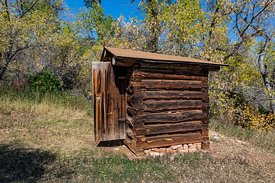 Log Outhouse at Caroline Lockhart Ranch in Bighorn Canyon