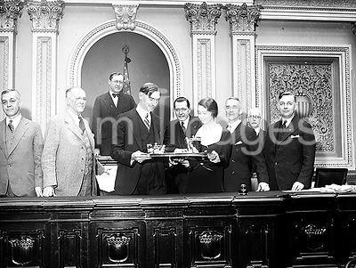 Congress, U.S. Capitol - Congressmen holding tray of what appears to be drinks, Washington, D.C. ca. 1932