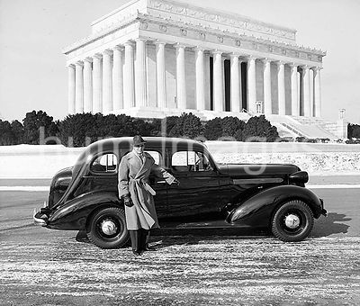 Man standing next to his car in front of the Lincoln Memorial ca. 1936