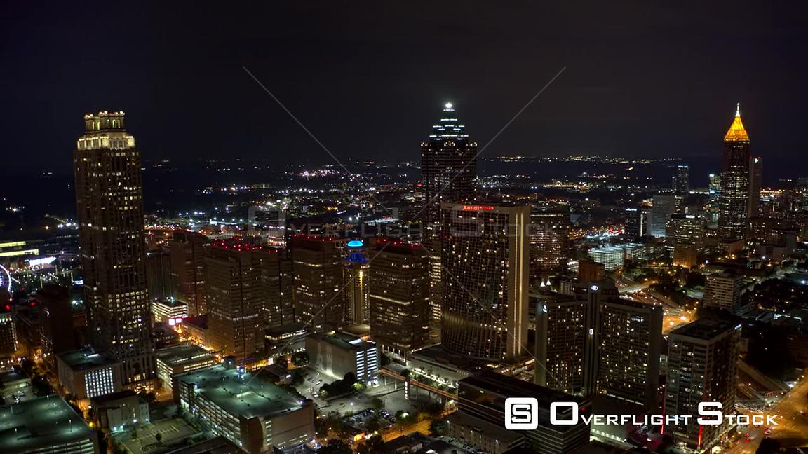 Atlanta Aerial Night hyperlapse of downtown, moving over and around freeway traffic