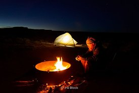 Camp fire and tent at Goosenecks State Park in Utah