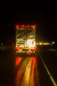 Semi on a Wet Road at Night