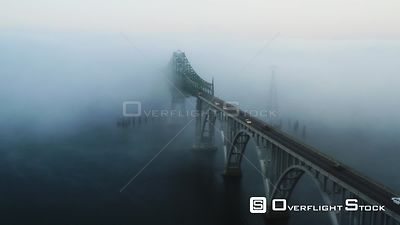 Conde B. McCullough Memorial Bridge in North Bend, Oregon in heavy fog.