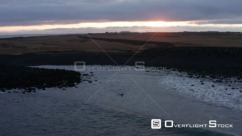 A Tracking Shot of a Surfer Paddling Out in Iceland.