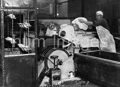 Dough being placed in dividing machine ca. 2/5/1919